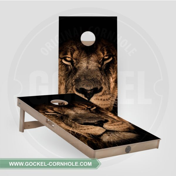 Cornhole boards with a lion print.