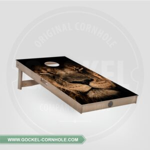Cornhole board with lion print.